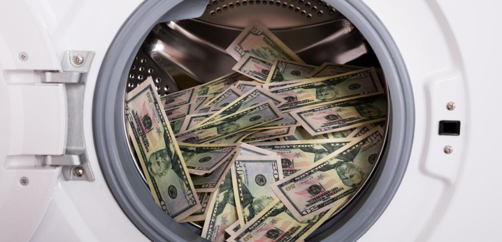 New Crypto money laundering. Dirty money in laundering machine.